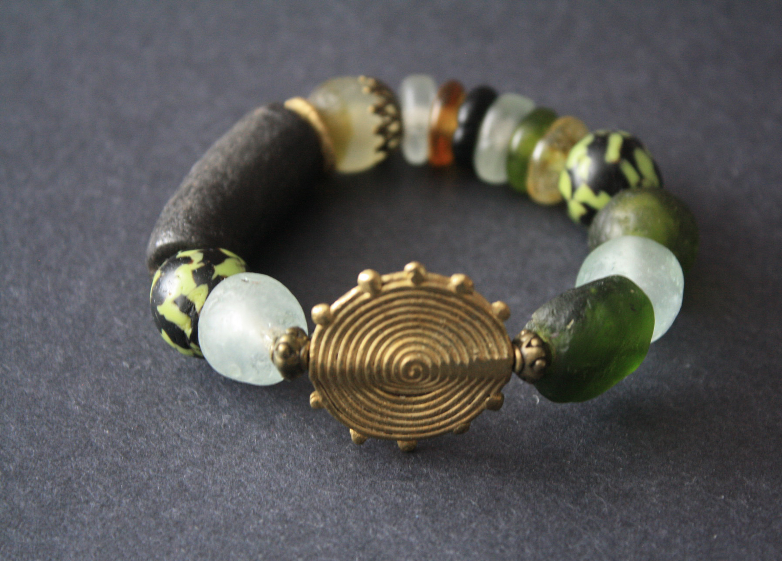 African-Bracelet–stretchy-Recycled-Glass-Green-and-Brass.full-view
