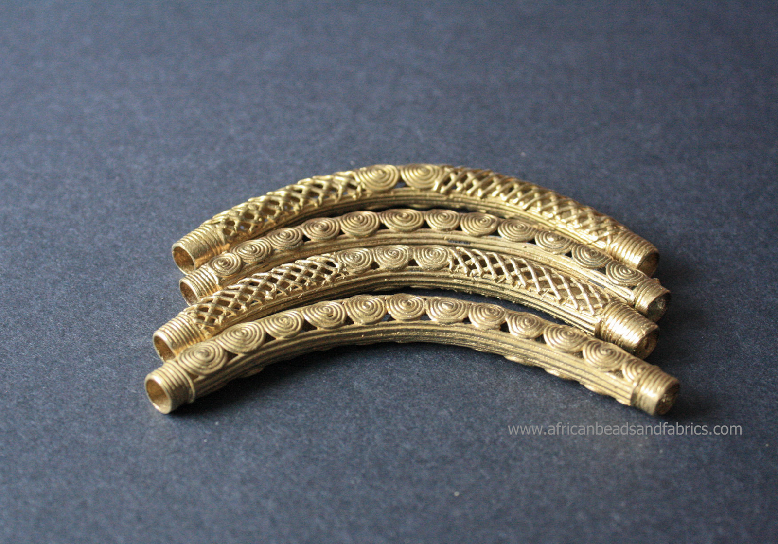 African-Brass-Bead-Long-curved-mesh-and-spiral–group-110mm-watermarked