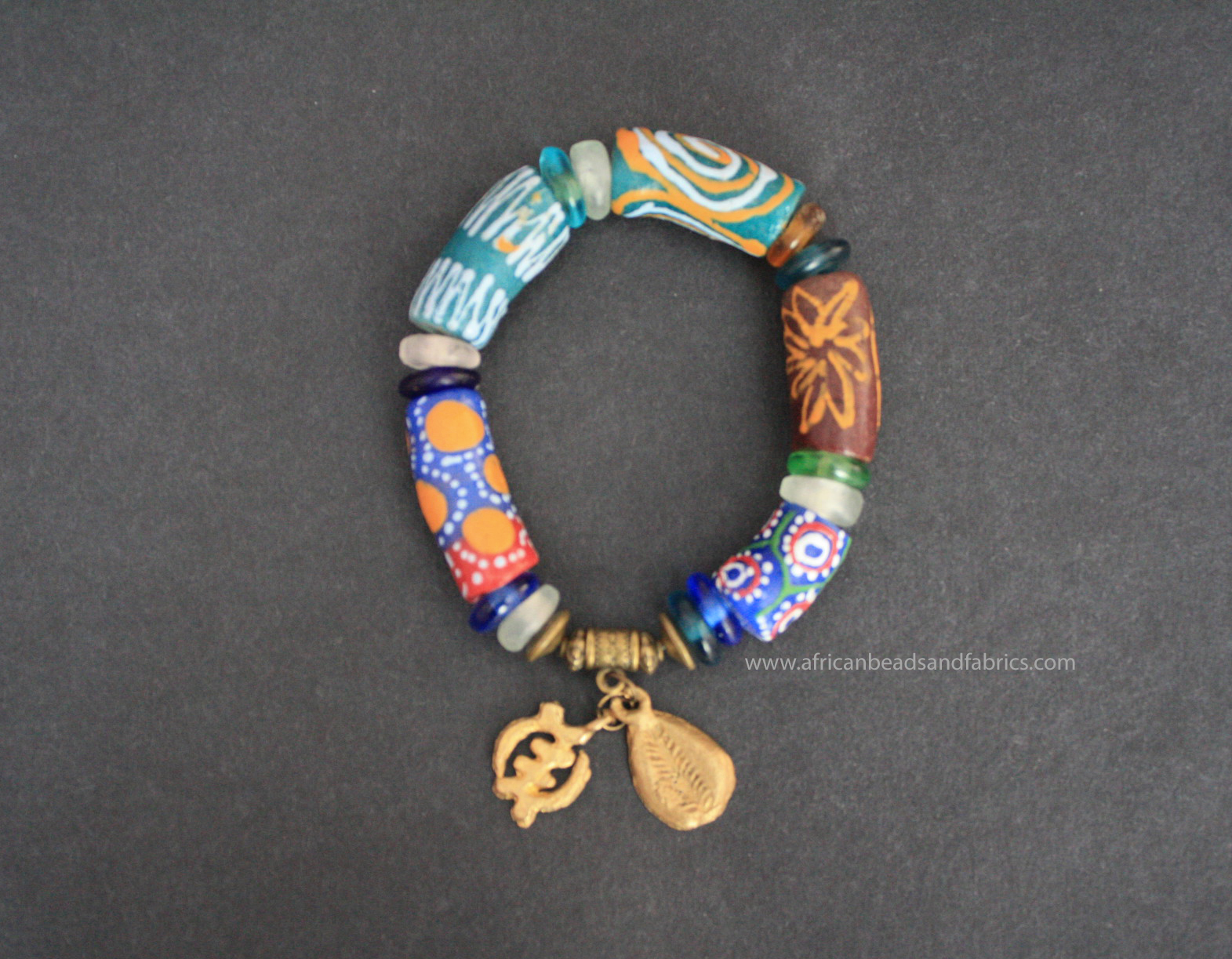 African-Adinkra-Bracelet-Ghana-Krobo-Recycled-Glass-two-brass-charms-gye-nyame-cowrie-watermarked
