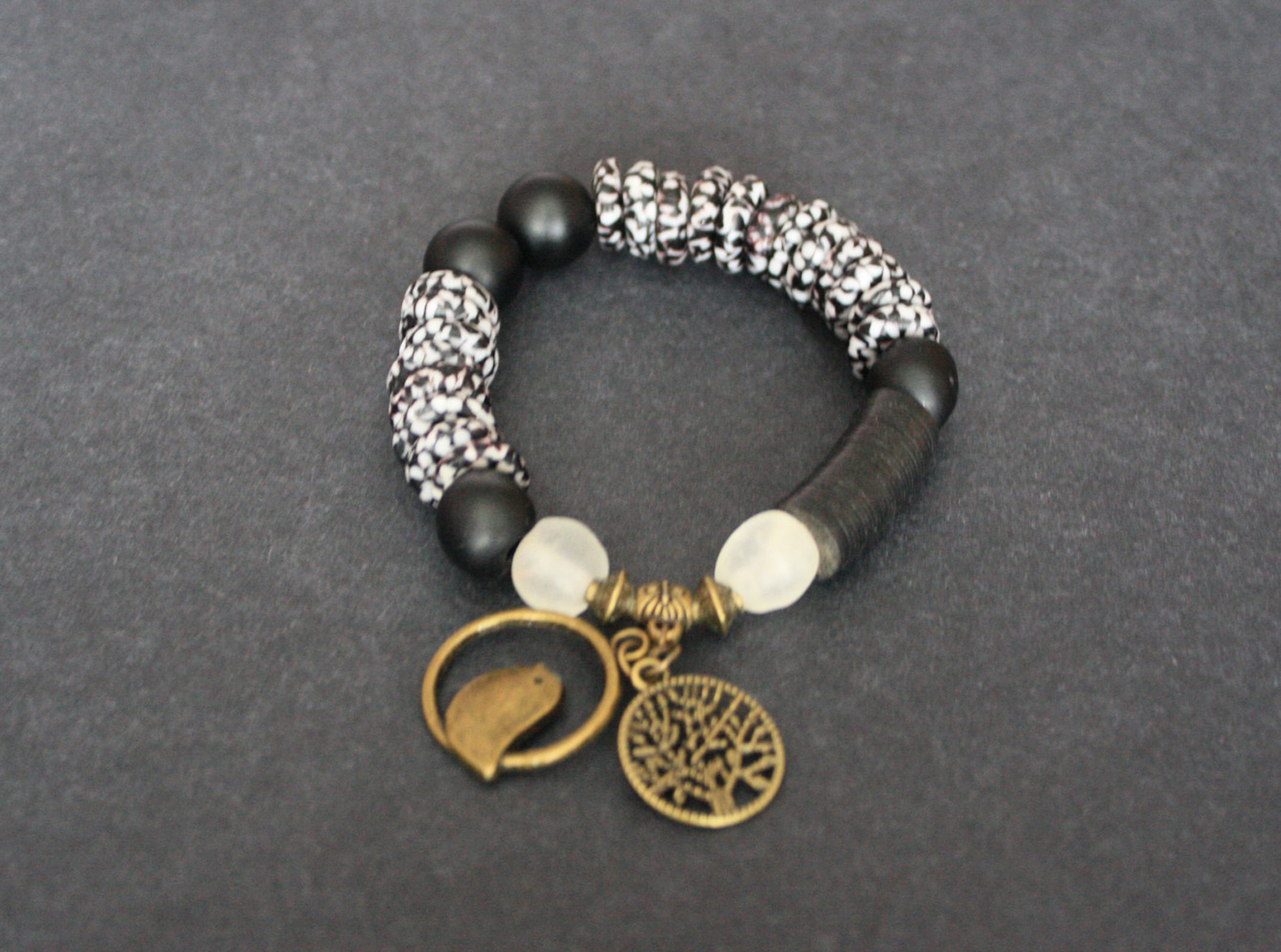 African-Bracelet-Ghana-Krobo-Refashioned-Glass-Discs–Black-white-with-Tree-of-Life-charms