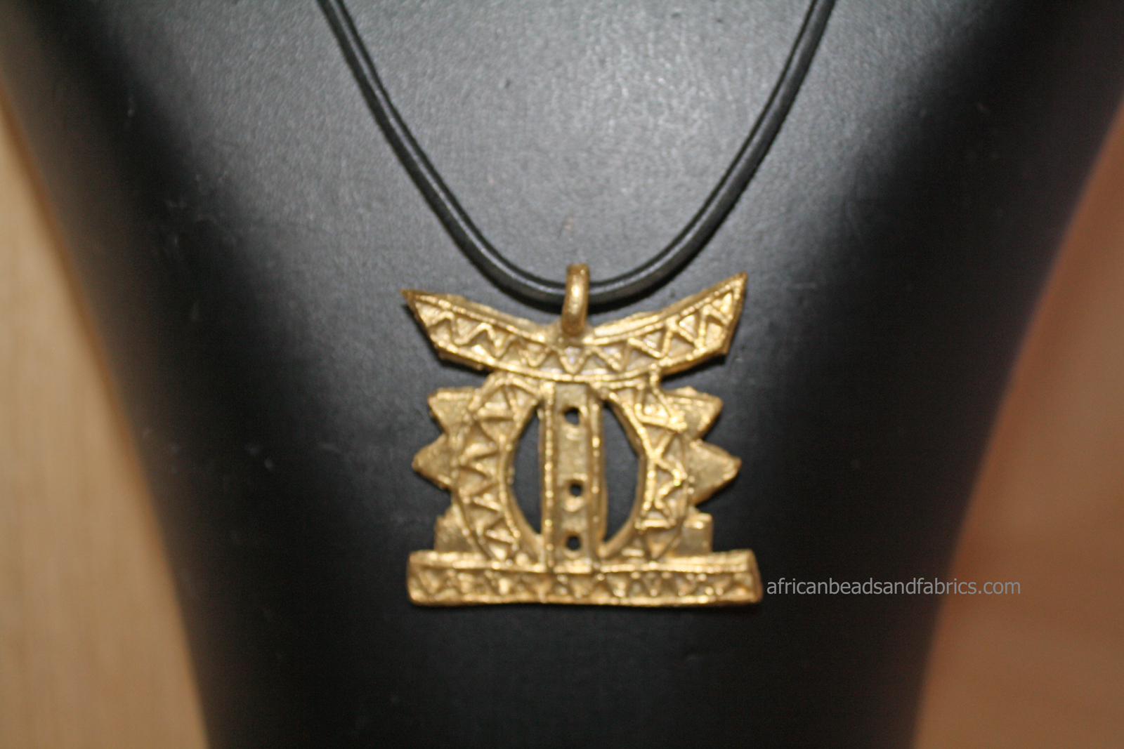 African-Tribal-stool-pendant-on-leather-cord-watermarked