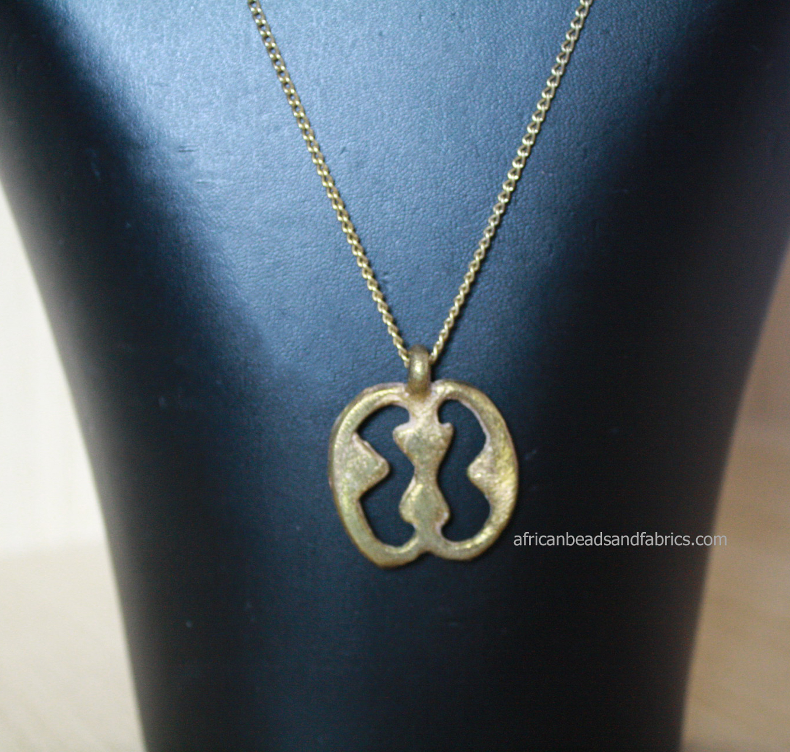 African-Jewellery-Brass-Adinkra-Pendant-on-Vintage-Curb-Human-Relations-watermarked